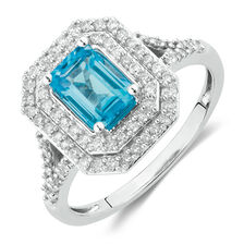Ring with Blue Topaz & 1/2 Carat TW of Diamonds in 10kt White Gold