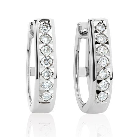 Huggie Earrings with 1/4 Carat TW of Diamonds ih 10kt White Gold