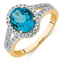 Ring with a Blue Topaz & Diamonds in 10kt Yellow Gold