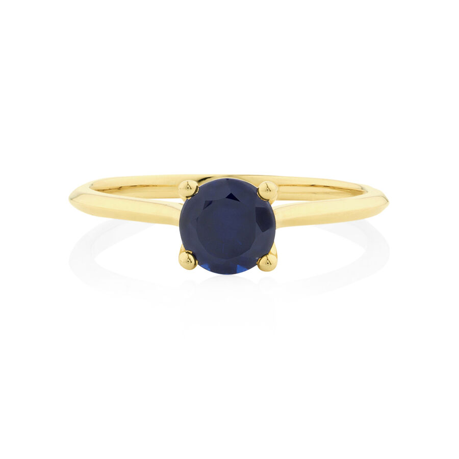Ring with Created Sapphire in 10kt Yellow Gold
