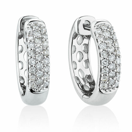 Huggie Earrings With 1/4 Carat TW Of Diamonds In 10kt White Gold