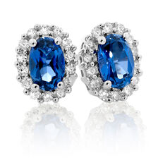 Stud Earrings with Created Sapphire & 1/5 Carat TW of Diamonds in 10kt White Gold