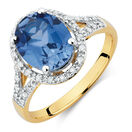 Ring with Created Sapphire & 1/5 Carat TW of Diamonds in 10kt Yellow & White Gold