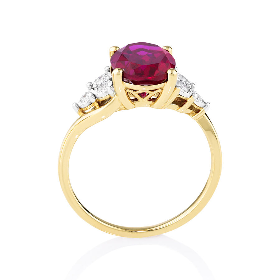 Ring with Created Ruby and Diamonds in 10kt Yellow Gold