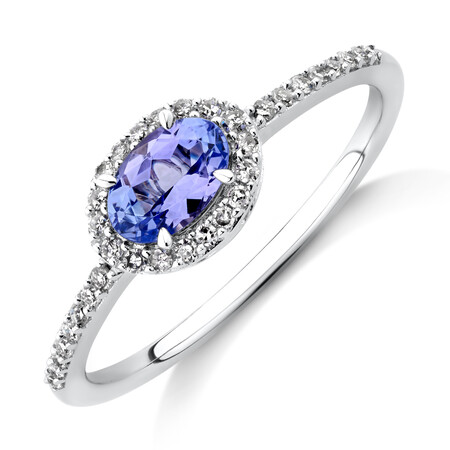Halo Ring with Tanzanite & 0.15 TW Carat Of Diamonds in 10kt White Gold