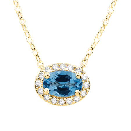 Pendant with Blue Topaz and Diamond in 10kt Yellow Gold