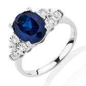 Ring with Created Sapphire & 0.10 Carat TW of Diamonds in 10kt White Gold