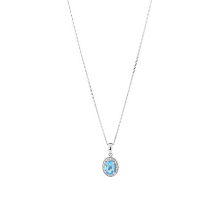 Halo Pendant with Blue Topaz and 0.04 carat TW of Diamonds in Sterling Silver