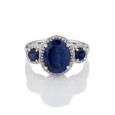 Three Stone Ring with Created Blue Sapphire & 0.20 Carat TW of Diamonds in 10kt White Gold