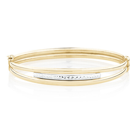Diamond Cut Oval Hinge Bangle in 10kt Yellow & White Gold