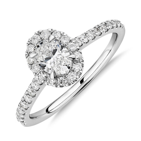 Halo Oval Engagement Ring with 0.92 Carat TW of Diamonds in 14kt White Gold