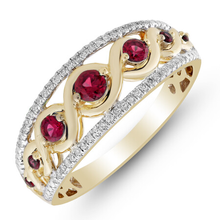 Ring with Created Ruby & 0.15 Carat TW of Diamonds in 10kt Yellow Gold