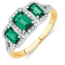 Three Stone Ring with Created Emerald and 1/4 Carat TW of Diamonds in 10kt Yellow Gold