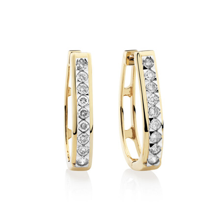Huggie Earrings with 0.50 Carat TW of Diamonds in 10kt Yellow Gold