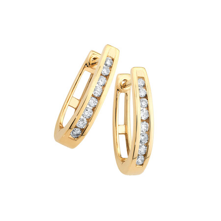Huggie Earrings with 0.25 Carat TW of Diamonds in 10kt Yellow Gold