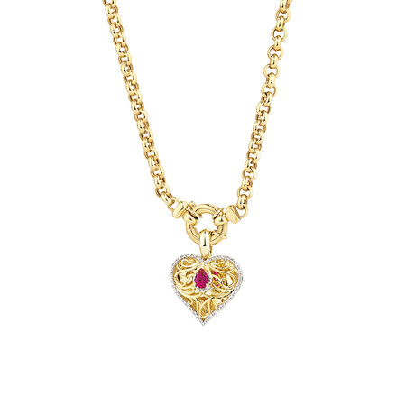 Heart Pendant with Created Ruby and 0.15 Carat TW of Diamonds in 10kt Yellow Gold