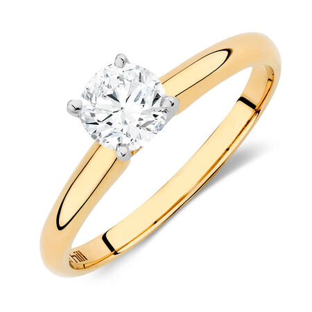 Solitaire Engagement Ring with a 0.69 Carat Diamond in 14kt Yellow & White Gold