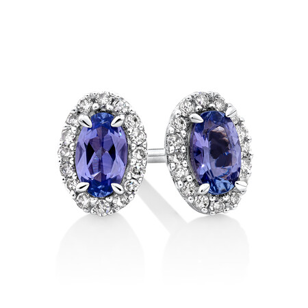 Halo Stud Earrings with Tanzanite & 0.12 TW Carat Of Diamonds in 10kt White Gold
