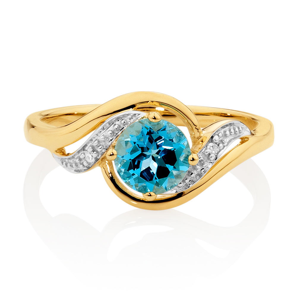 ring with blue topaz diamonds in 10kt yellow white gold