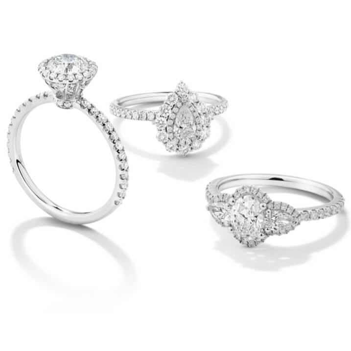 Our Sir Michael Hill Designer Bridal Collection features a range of beautiful silhouette capsules, including: new Designer Three Stone, new Designer Halo, Designer Double Halo, and Designer Solitaire with Pavé. Each ring is crafted to the highest workmanship standards, with diamonds individually hand-set by highly skilled craftsmen and finished with the signature hidden pink sapphire for a unique touch.